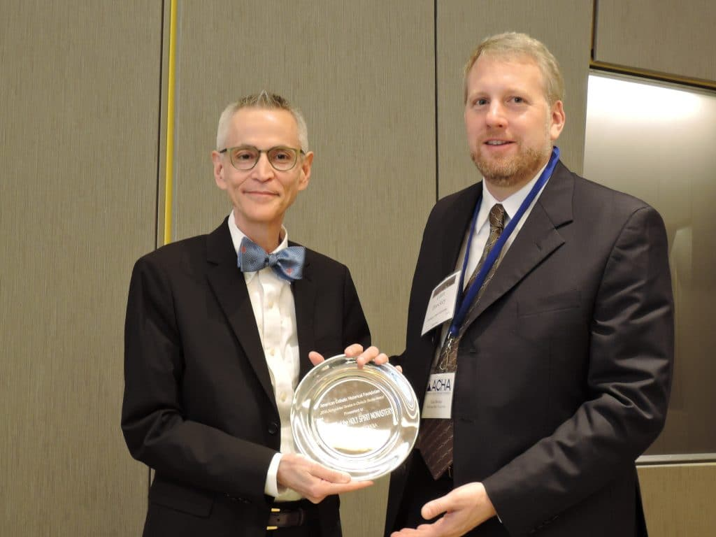 2016 ACHA President Liam Brockey presenting the Distinguished Scholar Award to Professor Walter Melion of Emory University