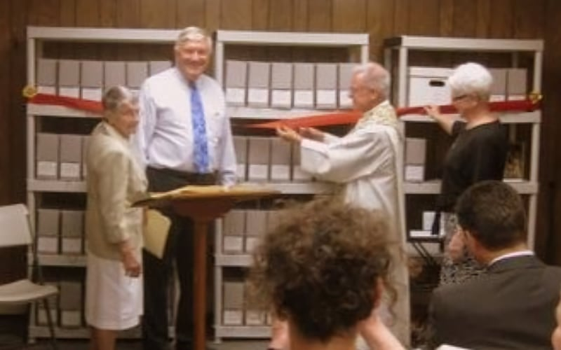 Pictured from left: Sister Nadine Boyle, RSM, Bob Golon, Parish Archivist, Fr. John Paul Alvarado, Pastor, and Sister Kathleen Rooney, SSJ at the opening ceremony of the Sacred Heart Archives. June, 2015.